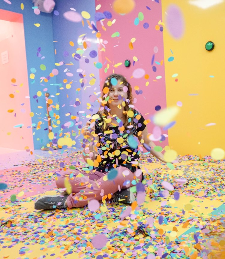 cute girl playing with confetti
