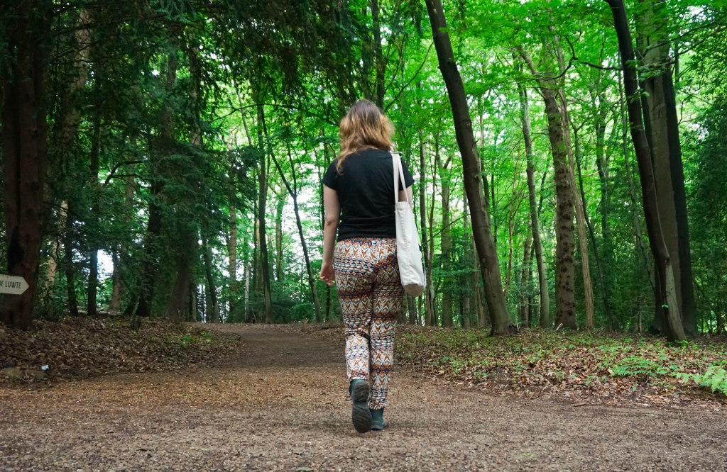 girl walking through forest