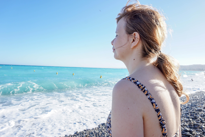 Girl in bikini enjoying the blue sea, cote d'azur in Nice France
