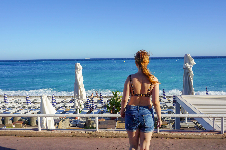 Girl in bikini overlooking the blue cote d'azur in Nice, France