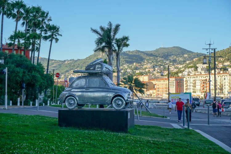 Car statue with mountains in the background, Nice, France